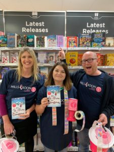 Our team holding a copy of I'll Be Home for Christmas in Asda